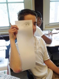 This Clissold student sketches an eye for his visual family tree in Spanish class